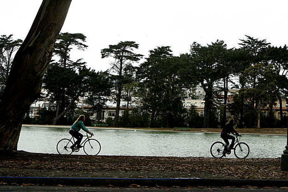 Bicyclists ride along the shore of Spreckels Lake in Golden Gate Park in San Francisco, Calif. on Monday,  July 28, 2008. Photo by Katy Raddatz / The Chronicle Photo: Katy Raddatz, The Chronicle