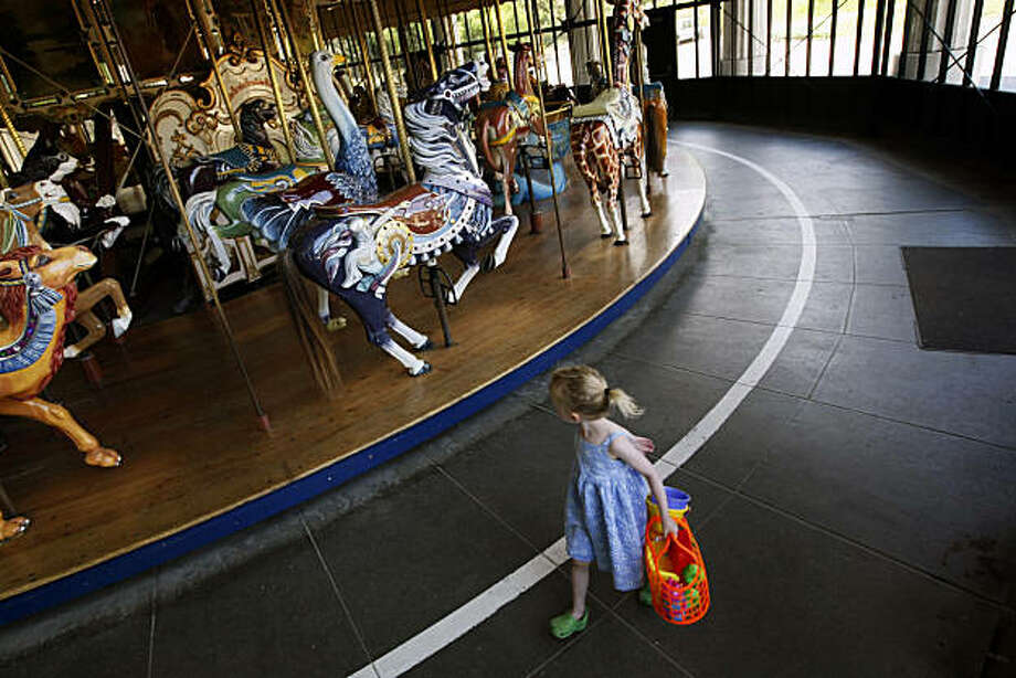 Lila Holt age 3 takes a last look while leaving one of the Bay Area's most historical Carousel, located in Golden Gate Park, on the west side of Koret Children's Quarter Playground. Tuesday June 30, 2009. Photo: Lance Iversen, The Chronicle