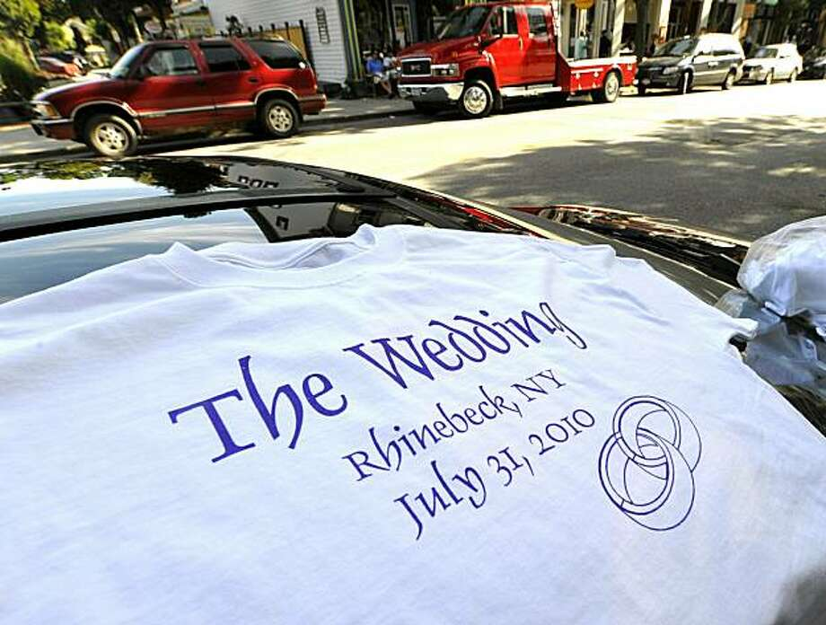"A t-shirt vendor sells ""The Wedding"" shirts in the town of Rhinebeck, New York where Chelsea Clinton's multimillion-dollar wedding will take place in the tiny town of Rhinebeck, 100 miles (160km) north of New York City. Photo: Timothy A. Clary, AFP/Getty Images"