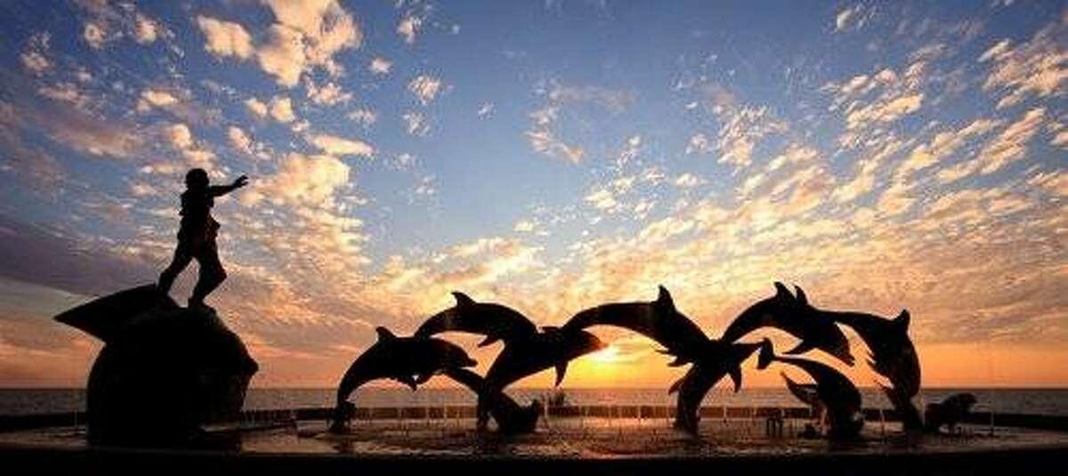 Dolphin statues, representing intelligence, along Mazatlan's malecon.