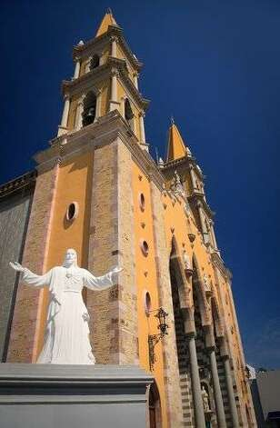 A statue of Jesus greats worshipers at Mazatlan's cathedral. Photo: Steve Heap, Shutterstock