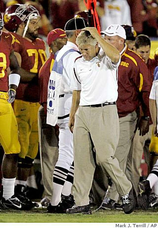 Southern California coach Pete Carroll rubs his head in the closing seconds against Stanford, Saturday, Oct. 6, 2007, in Los Angeles. Stanford upset USC 24-23. Photo: Mark J. Terrill, AP