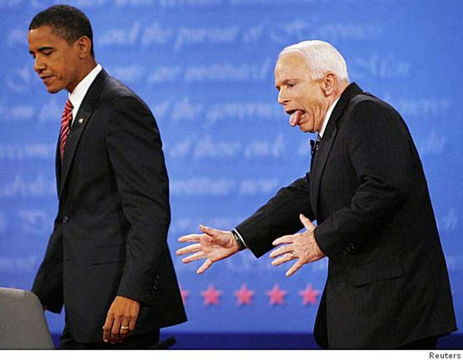 """ATTENTION EDITORS - REUTERS PICTURE HIGHLIGHT TRANSMITTED BY 0535 GMT ON OCTOBER 16, 2008.HEM25US Republican presidential nominee Senator John McCain (R-AZ) reacts to almost heading the wrong way off the stage after shaking hands with Democratic presidential nominee Senator Barack Obama (D-IL) at the conclusion of the final presidential debate at Hofstra University in Hempstead, New York.REUTERS NEWS PICTURES HAS NOW MADE IT EASIER TO FIND THE BEST PHOTOS FROM THE MOST IMPORTANT STORIES AND TOP STANDALONES EACH DAY By searching in the IPTC Supplemental Category code for """"TPX"""" you will find a selection of 80-100 of our daily Top Pictures.REUTERS NEWS PICTURES, SINGAPORETEMPLATE OUT Photo: STAFF, Reuters"""