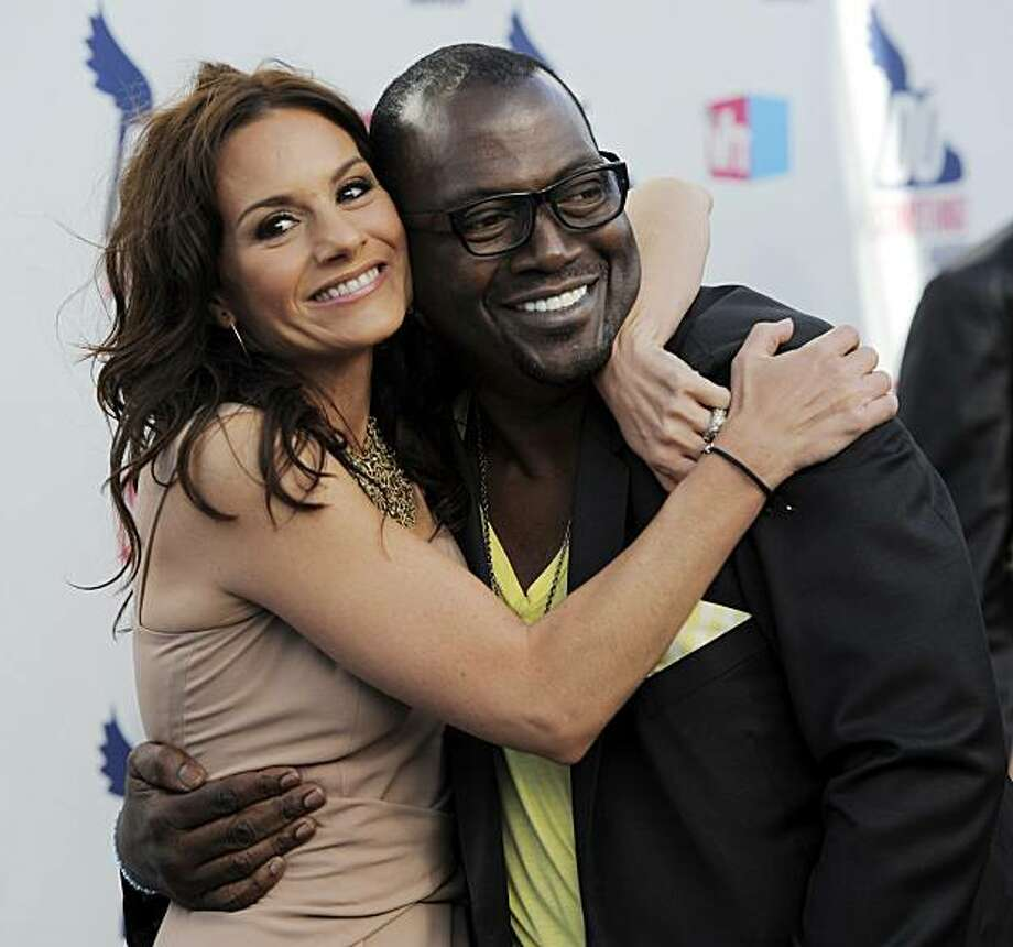 """American Idol"" judges Kara DioGuardi, left, and Randy Jackson hug on the red carpet at the 2010 VH1 Do Something Awards in Los Angeles, Monday, July 19, 2010. Photo: Chris Pizzello, AP"