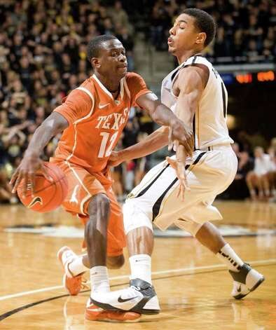 Missouri's Phil Pressey, right, steps on the foot of Texas' Myck Kabongo, left, as he tries to dribble toward the basket during the first half of an NCAA college basketball  game Saturday, Jan. 14, 2012, in Columbia, Mo. Missouri won the game 84-73. Photo: Associated Press, L.G. PATTERSON