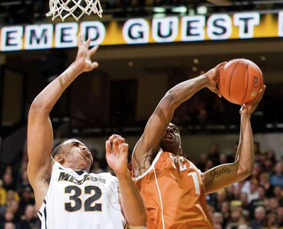 Texas' Sheldon McClellan, right, fails to get a shot off as he is defended by Missouri's Steve Moore, left, during the first half of an NCAA college basketball game, Saturday, Jan. 14, 2012, in Columbia, Mo. Missouri won the game 84-73. Photo: Associated Press, L.G. PATTERSON