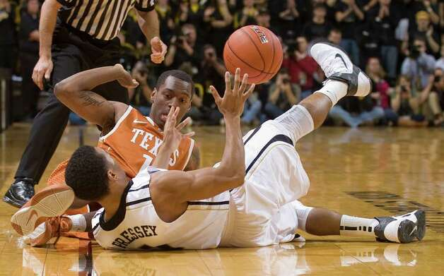 Missouri's Phil Pressey, bottom, and Texas' Sheldon McClellan, top, battle for a loose ball before it goes out of bounds during the first half of an NCAA college basketball  game Saturday, Jan. 14, 2012, in Columbia, Mo. Photo: Associated Press, L.G. PATTERSON
