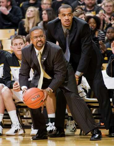 Missouri head coach Frank Haith, left, grabs the ball with help from injured player Lawrence Bowers, right, as it goes out of bounds during the first half of an NCAA college basketball game against Texas Saturday, Jan. 14, 2012, in Columbia, Mo. Photo: Associated Press, L.G. PATTERSON