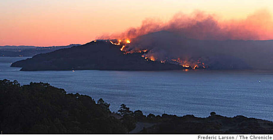 Angel Island is ablaze, with a view of Mount Diablo in the background, during the Monday morning twilight on October 13, 2008 in this view from the Marin Headlands. Photo: Frederic Larson, The Chronicle