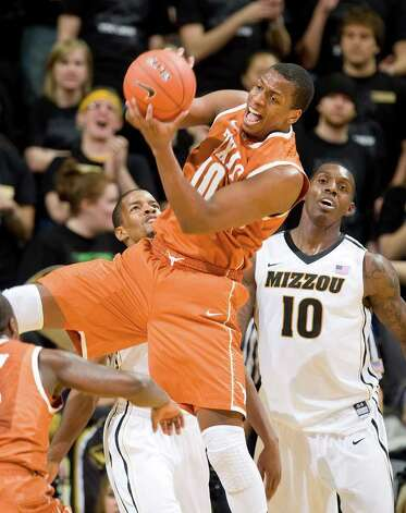 Texas' Jonathan Holmes, center, pulls down a rebound in front of Missouri's Ricardo Ratliffe, right, and Kim English, left, during the first half of an NCAA college basketball  game Saturday, Jan. 14, 2012, in Columbia, Mo. Photo: Associated Press, L.G. PATTERSON