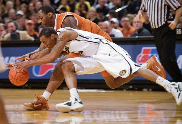 Missouri's Marcus Denmon, bottom, battles Texas' Sheldon McClellan, top, for a loose ball during the first half of an NCAA college basketball game Saturday, Jan. 14, 2012, in Columbia, Mo. Photo: Associated Press, L.G. PATTERSON