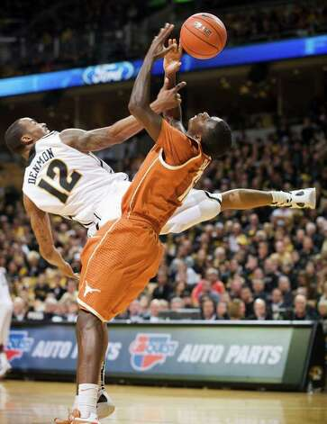 Missouri's Marcus Denmon, left, and Texas' Myck Kabongo, right, collide as they battle for a rebound during the second half of an NCAA college basketball game Saturday, Jan. 14, 2012, in Columbia, Mo. Missouri won the game 84-73. Photo: Associated Press, L.G. PATTERSON