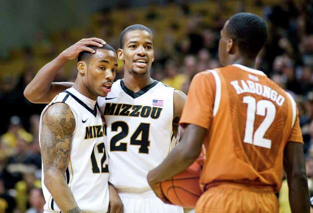 Missouri's Kim English, center, celebrates with teammate Marcus Denmon, left, as Texas' Myck Kabongo, right, looks on late in the second half of an NCAA college basketball game Saturday, Jan. 14, 2012, in Columbia, Mo. Missouri won the game 84-73. Photo: Associated Press, L.G. PATTERSON