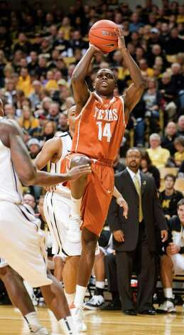 Texas' J'Covan Brown, right, shoots two of his game-high 34 points past Missouri's Matt Pressey, back, during the first half of an NCAA college basketball game Saturday, Jan. 14, 2012, in Columbia, Mo. Missouri won the game 84-73. Photo: Associated Press, L.G. PATTERSON