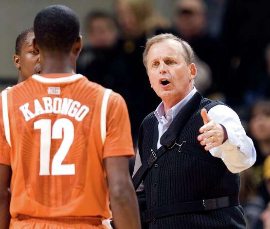 Texas head coach Rick Barnes, right, talks with Myck Kabongo during a time out in the first half of an NCAA college basketball game against Missouri Saturday, Jan. 14, 2012, in Columbia, Mo. Photo: Associated Press, L.G. PATTERSON