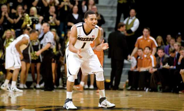 Missouri's Phil Pressey, center, celebrates after he scoring during the second half of an NCAA college basketball game against Texas Saturday, Jan. 14, 2012, in Columbia, Mo. Missouri won the game 84-73. Photo: Associated Press, L.G. PATTERSON