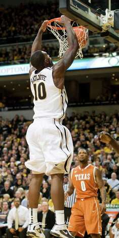 Missouri's Ricardo Ratliffe, left, dunks the ball over Texas' Julien Lewis, right, for two of his team-high 21 points during the second half of an NCAA college basketball game Saturday, Jan. 14, 2012, in Columbia, Mo. Missouri won the game 84-73. Photo: Associated Press, L.G. PATTERSON