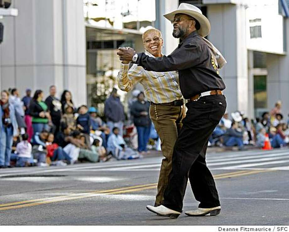 The Oakland Black Cowboy parade makes its way down 14th Street in downtown Oakland. Photo: Deanne Fitzmaurice, SFC