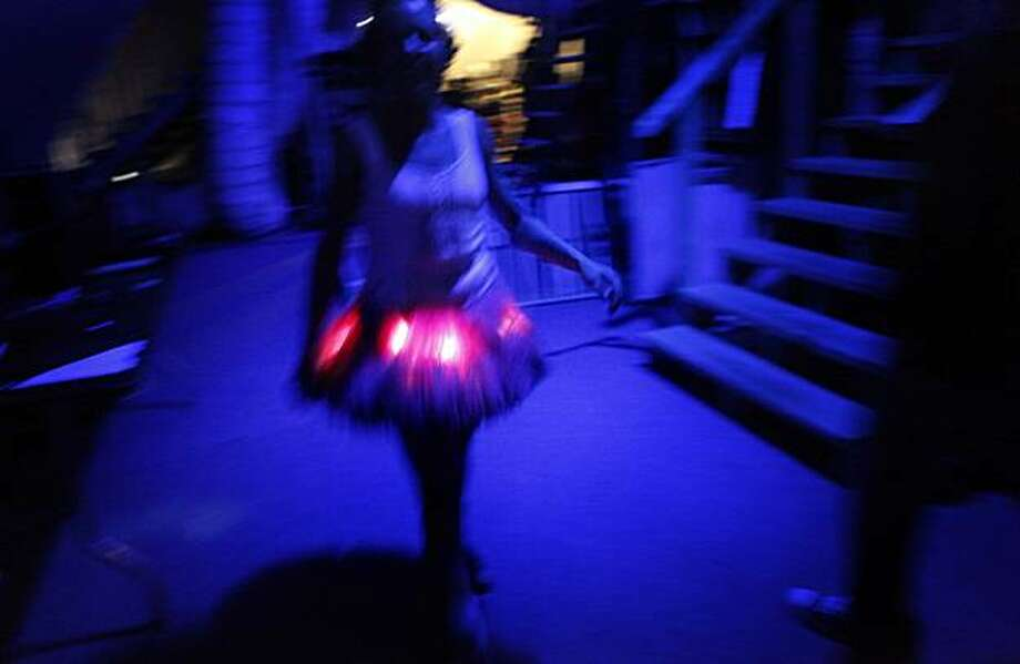 Backstage - 8:11 p.m. - San Francisco, Calif.   While working on an assignment backstage at the Peter Pan production near Justin Herman Plaza, I snapped this picture of Tinkerbell prancing past my camera. It was a delightfully surreal moment to have witnessed and my 4-year-old was really excited when I told her what I saw that night.  Camera settings: Canon 5D MkII, ISO 6400, 1/20, f2.8,  24mm Photo: Mike Kepka, The Chronicle