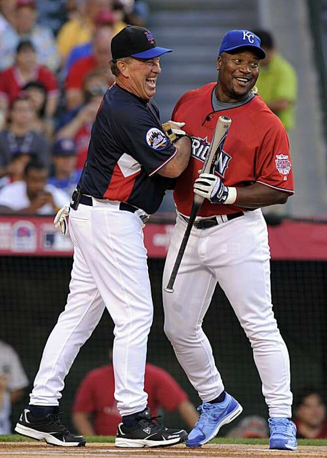 Bo Jackson, right, and Gary Carter joke around during the All-Star Legends & Celebrity softball game, Sunday, July 11, 2010, in Anaheim, Calif. Photo: Mark J. Terrill, AP