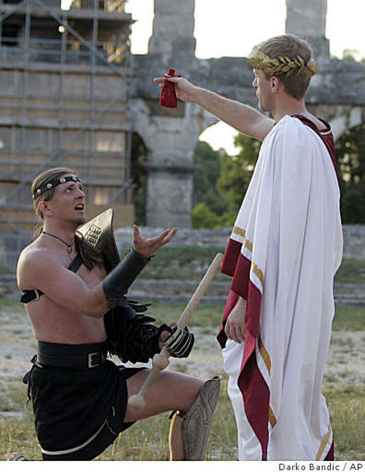 Gladiators, members of the Hungarian Collegium Gladiatorium fighting club perform in the Roman amphitheater in the port city of Pula, Croatia, Saturday, May 23, 2009, during the Antiquity festival, which opens the tourist season in Pula. Photo: Darko Bandic, AP