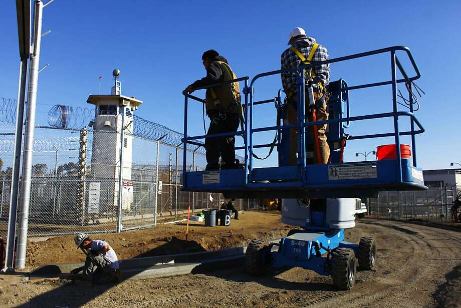 Workers work at a outside the new care facility at the California Medical Facility in Vacaville on Friday, January 13, 2012 in Vacaville, Calif. Photo: Lea Suzuki, The Chronicle