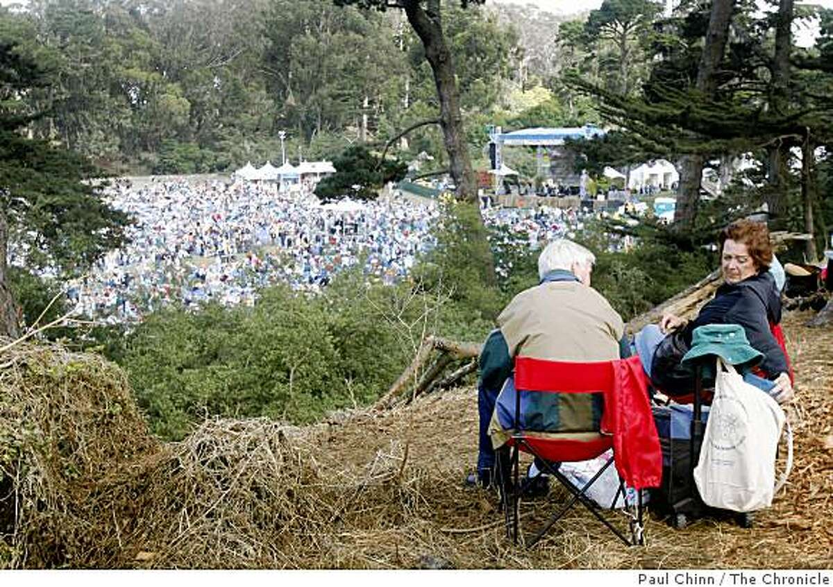 Bob and Barbara Faulkner settled on a view from a hill above the crowd at the annual Hardly Strictly Blues Festival at Golden Gate Park in San Francisco, Calif., on Saturday, Oct. 4, 2008.