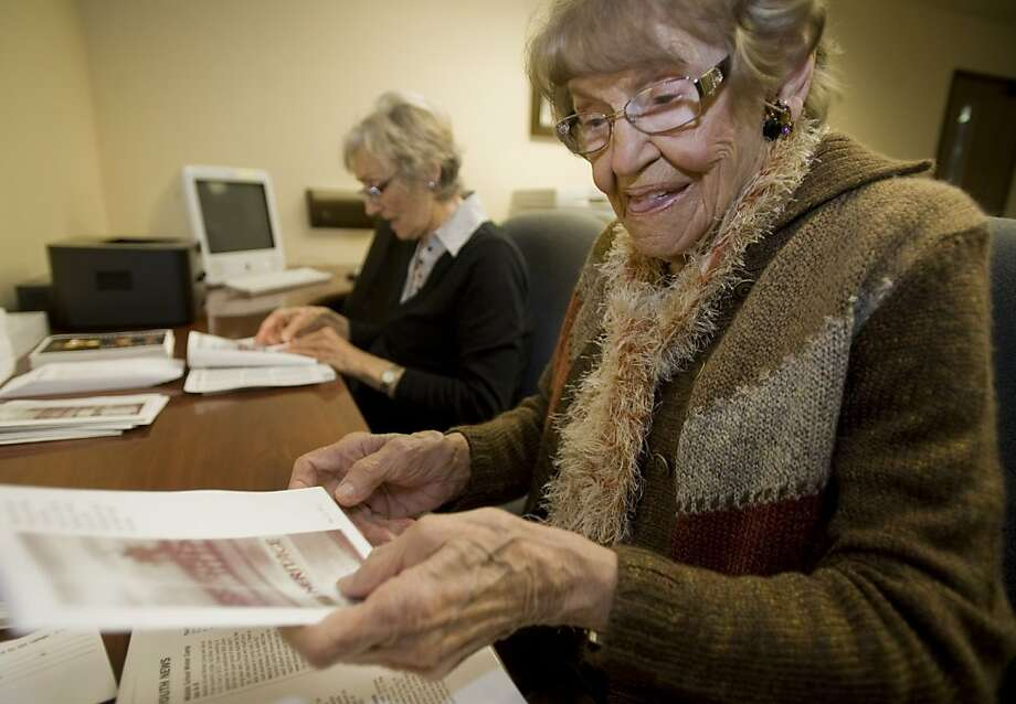 In this Dec. 12, 2011 photo, Minka Disbrow, 100, right, does office work with friend June Alabran, left, at  Heritage Christian Fellowship in San Clemente, Calif. where the two attend church. Disbrow, who was raped at age 16, in 2006 met the daughter she gave up at birth 77 years earlier and learned about the six grandchildren she didn't know she had. (AP Photo/Orange County Register, Ana Venegas)   MAGS OUT; LOS ANGELES TIMES OUT Photo: Ana Venegas, Associated Press
