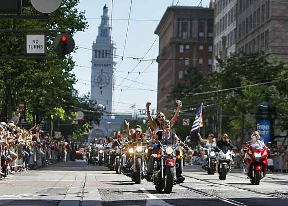 The crowd of thousands cheer as Dykes on Bikes leads the 40th annual Gay Pride Parade on Sunday in San Francisco. Photo: Lacy Atkins, The Chronicle