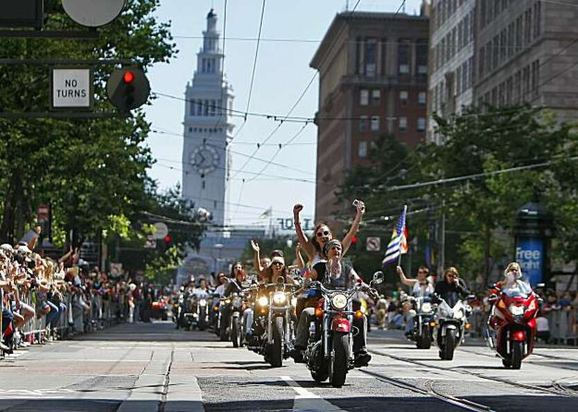 The crowd of thousands cheer as Dykes on Bikes leads the 40th annual Gay Pride Parade on Sunday in S
