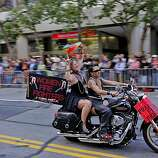 The crowd cheers as Dykes on Bikes leads the 40th annual Gay Pride Parade down Market Street on Sunday in San Francisco.