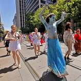 Keled Sira dances as he marches with the Garza group in the 40th annual Gay Pride Parade on Sunday in San Francisco.