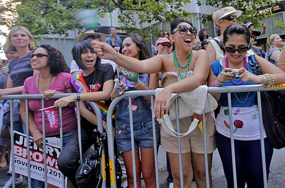 Atzimba Carbajal stands in the center of her family and cheers as the Gay Pride Parade marches down Market Street on Sunday in San Francisco. Photo: Lacy Atkins, The Chronicle