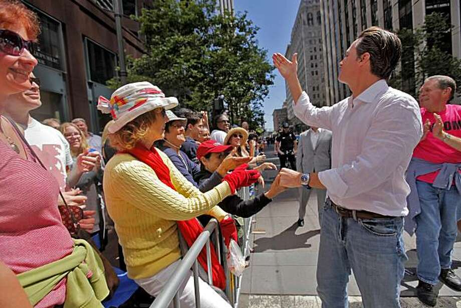 Mayor Gavin Newsom blows a kiss to the crowd as he walks in the 40th annual Gay Pride Parade on Sunday in San Francisco. Photo: Lacy Atkins, The Chronicle