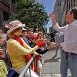 Mayor Gavin Newsom blows a kiss to the crowd as he walks in the 40th annual Gay Pride Parade on Sunday in San Francisco.