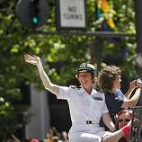 Navy Reserve Commander Zoe Dunning and her partner, Pam Grey, wave and photograph the thousands watching the 40th annual Gay Pride Parade on Sunday in San Francisco. Zoe made history when she came out as a lesbian and won her discharge case against the military.