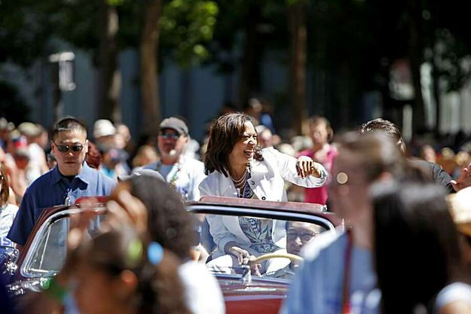 District Attorney Kamala Harris waves to the crowd as she rides in the 40th annual Gay Pride Parade on Sunday in San Francisco. Photo: Lacy Atkins, The Chronicle
