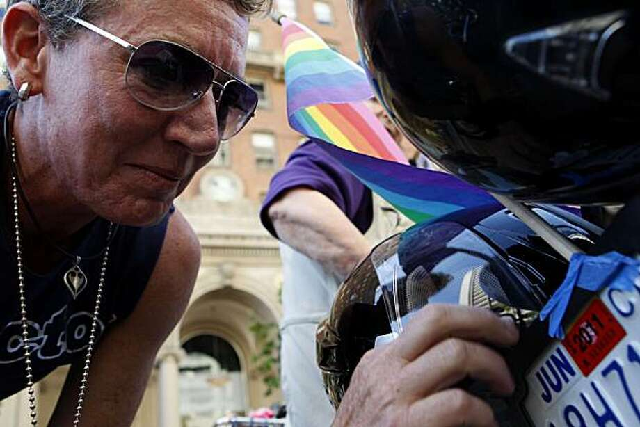 Char Stevens secures her rainbow flag to the back of her motorcycle while waiting for the 40th annual Pride Parade to begin on Sunday in San Francisco. Photo: John Sebastian Russo, The Chronicle