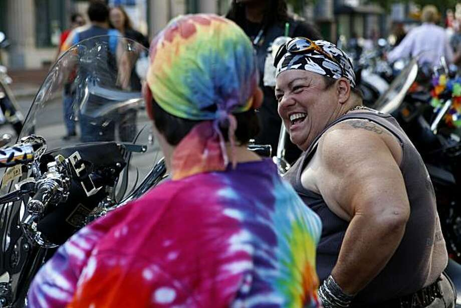 Diane Foto (right) jokes with Kristie Isemann while waiting for the start of the 40th annual Pride Parade on Sunday in San Francisco. Both traveled from New Orleans to participate. Photo: John Sebastian Russo, The Chronicle