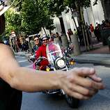 Christine Svendsen of the Monterey Chapter of the Dykes on Bikes directs newly arriving participants of the 40th annual Pride Parade to their rallying points on Market Street on Sunday in San Francisco.