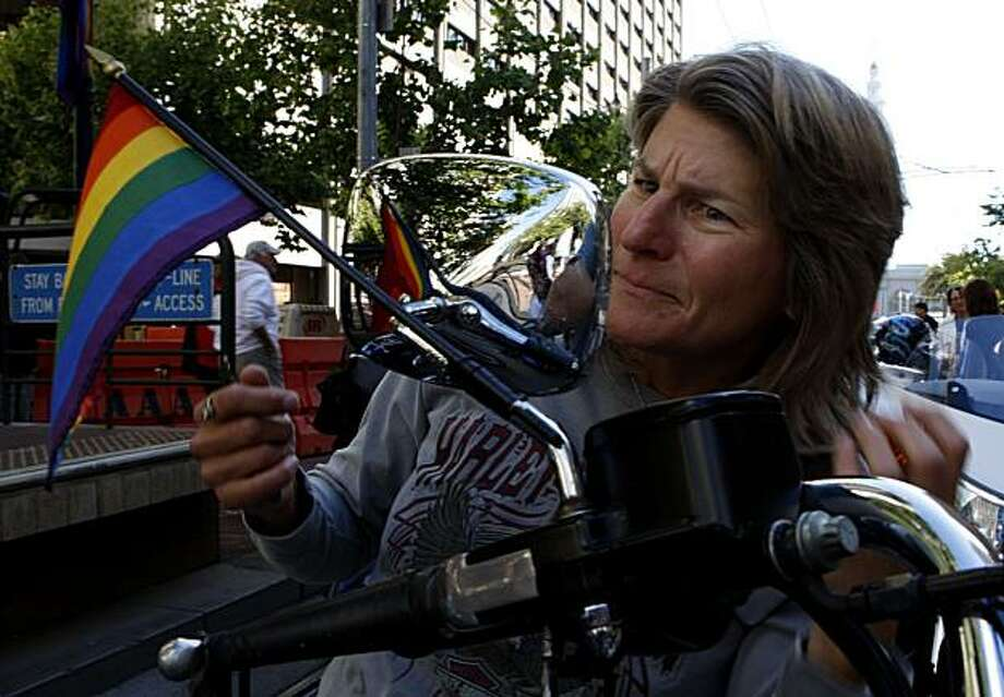 Gail Tillotson of Santa Rosa checks her hair in the mirror of her motorcycle shortly before the Dykes on Bikes lead the way down Market Street during the 40th annual Pride Parade on Sunday in San Francisco. Photo: John Sebastian Russo, The Chronicle