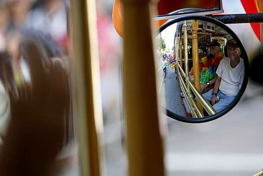 Members of New Leaf Services of San Francisco ride down Market Street in a cable car during the 40th annual Pride Parade on Sunday in San Francisco. Photo: John Sebastian Russo, The Chronicle