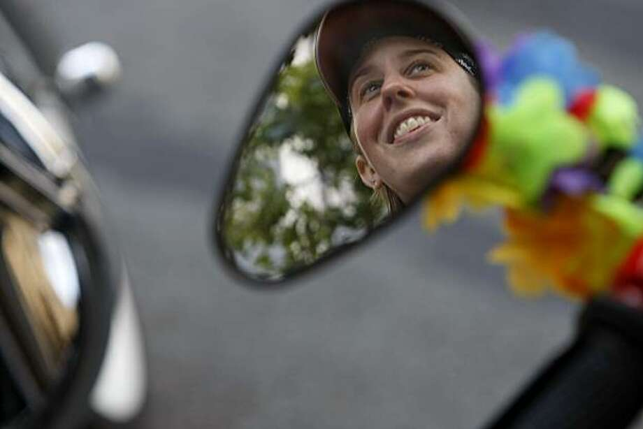 Jennifer Rafiner from Martinez sits on her motorcycle waiting for the 40th annual Pride Parade to begin on Sunday in San Francisco. Photo: John Sebastian Russo, The Chronicle