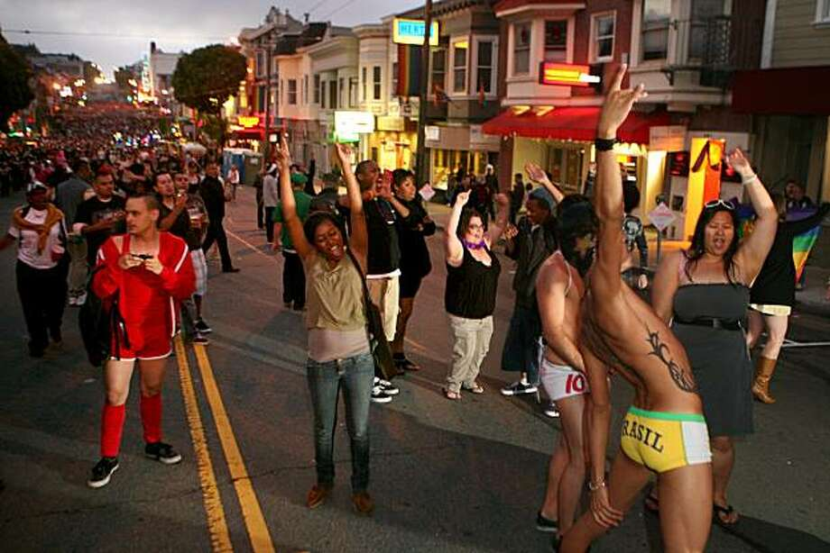 "A crowd dances at the ""Global Village Stage"" in the Castro District at the after party for the 18th annual San Francisco Dyke March from Dolores Park to the Castro on Saturday. Photo: Kat Wade, Special To The Chronicle"