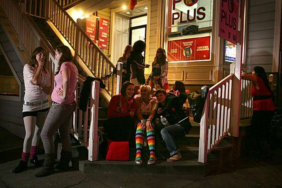 A group of ladies hangs out at the after party early Sunday for Saturday's 18th Annual San Francisco Dyke March from Dolores Park to the Castro. Photo: Kat Wade, Special To The Chronicle