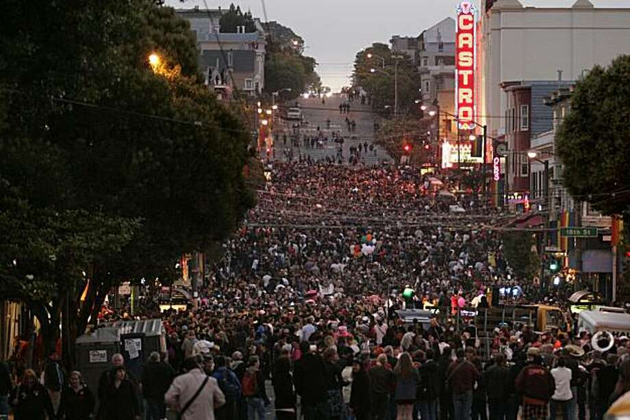 A huge crowd gathers in the Castro District for the after party for the 18th annual San Francisco Dyke March from Dolores Park on Saturday. Photo: Kat Wade, Special To The Chronicle