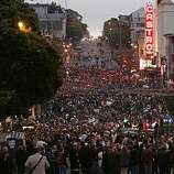 A huge crowd gathers in the Castro District for the after party for the 18th annual San Francisco Dyke March from Dolores Park on Saturday.