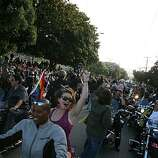 Chere Beasley of Richmond and Melody Sage are in the first group of Dykes on Bikes leading the 18th annual Dyke March up 16th Street from Dolores Park in San Francisco on Saturday.