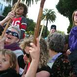 From left, Elyse Gay, Muin Galy Loram Duke, 4, (rear) Emilio Sanchez-Aquila, 4, (foreground), Ellen Aquila and Bela Guerra, 5, cheer as Dykes on Bikes lead off the 18th annual Dyke March up 16th Street from Dolores Park in San Francisco on Saturday.