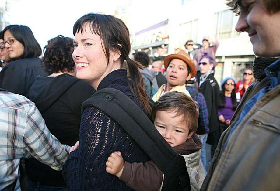 Sarah Neidhart, son Levi Reyes and partner Cat Reyes of San Francisco march in the 18th annual Dyke March up 16th Street from Dolores Park in San Francisco on Saturday. Photo: Kat Wade, Special To The Chronicle